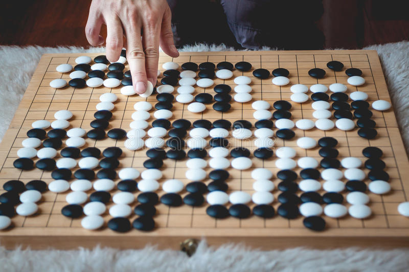 Man playing Go board game stock photography