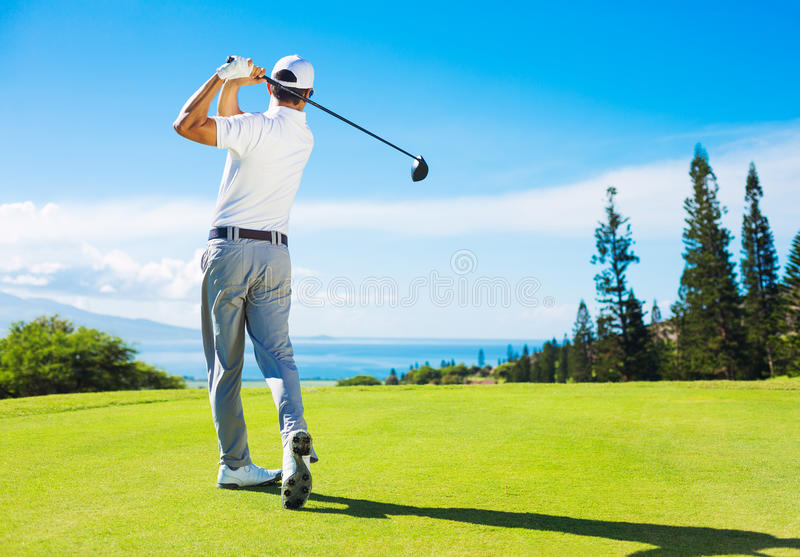 Man Playing Golf, Hitting Ball from the Tee royalty free stock photos
