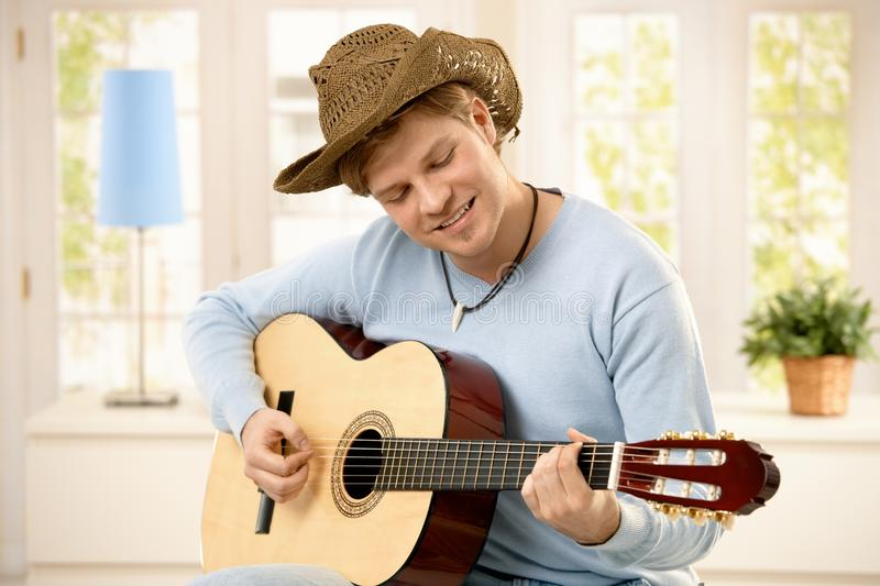 Download Man playing guitar stock image. Image of home, american - 16418793