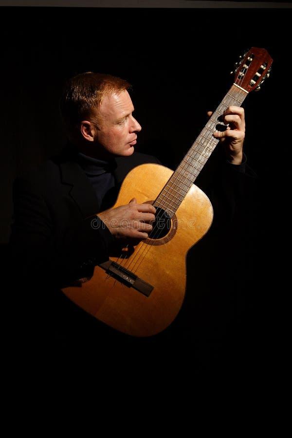 Download Man playing a guitar stock image. Image of black, hair - 1652099