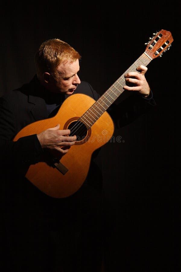 Man Playing A Guitar Stock Photography