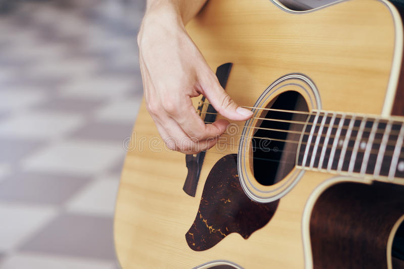 Man playing the guitar, close-up, hands royalty free stock photography