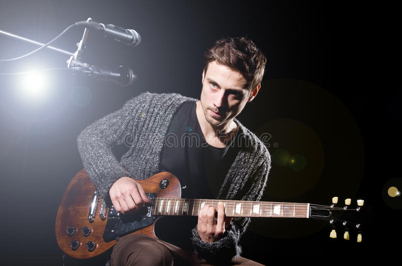 Download Man playing guitar stock image. Image of discotheque - 32810547