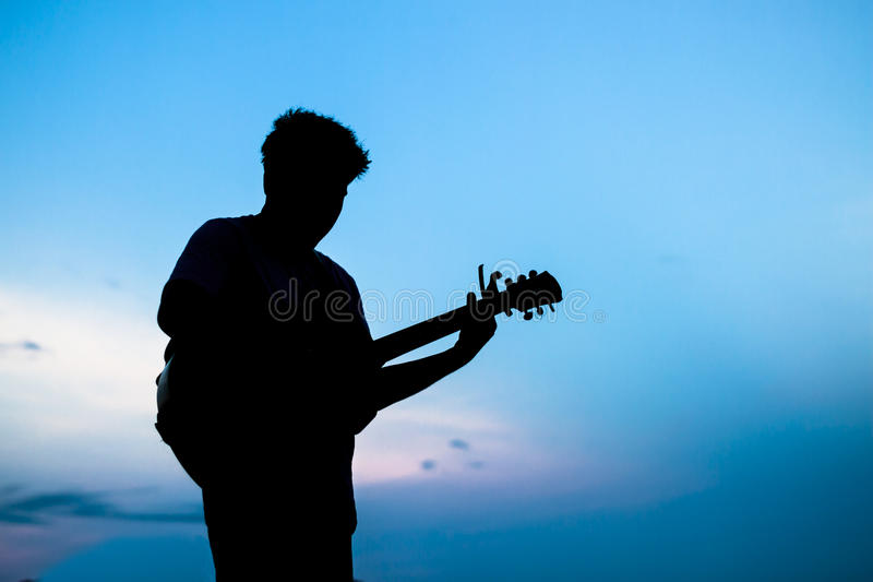 Man playing the guitar stock photo