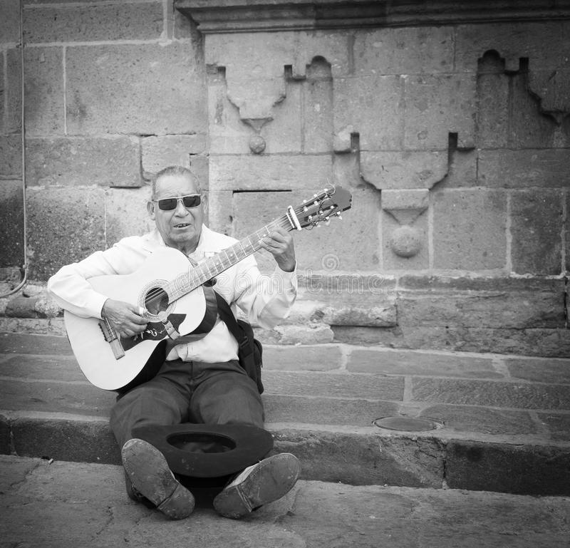 Man Playing Guitar on Street, Mexico royalty free stock photo