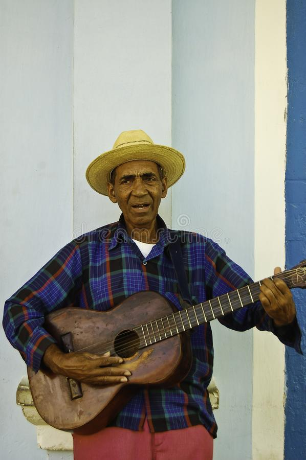 Man playing guitar in Trinidad, a beautiful colonial city in Cuba royalty free stock images