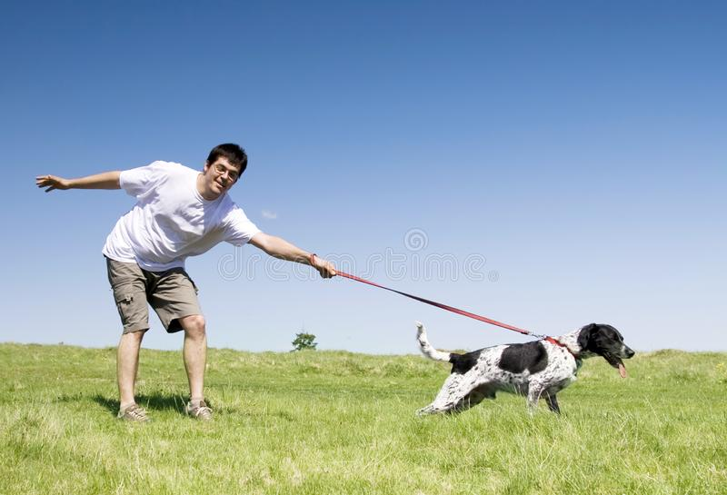 Man playing with his dog stock photos