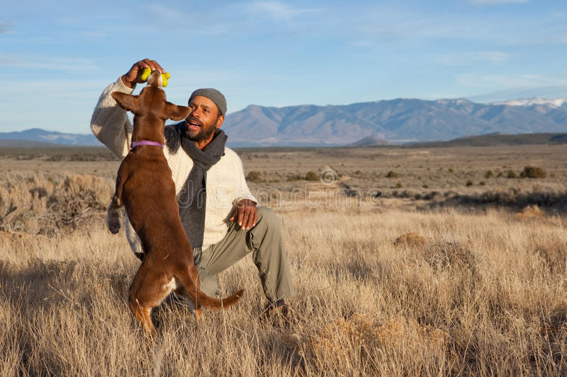 Man playing with his dog royalty free stock photos