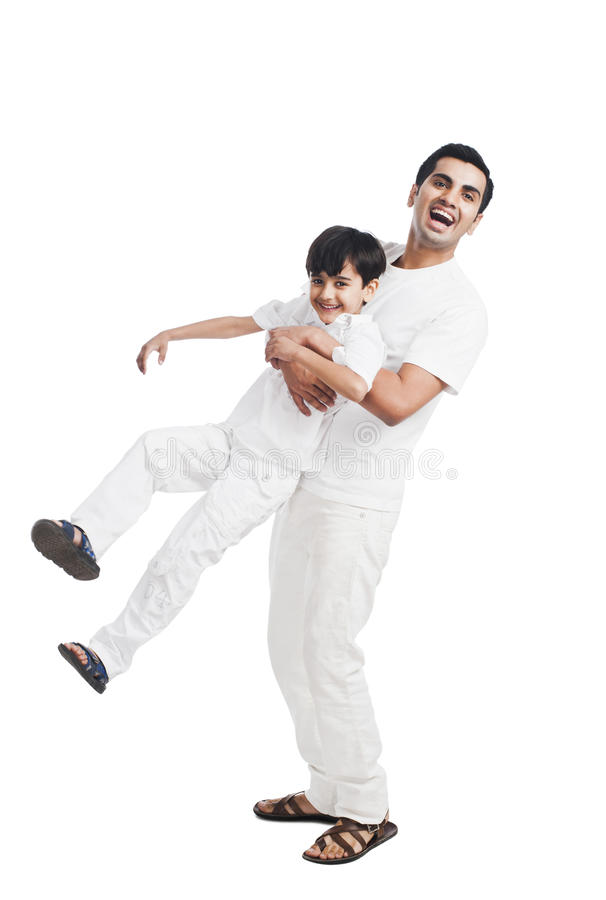 Man playing with his son royalty free stock photos