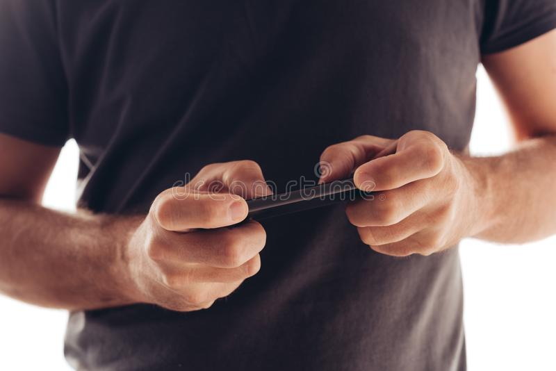 Man playing mobile video game on smartphone royalty free stock photo