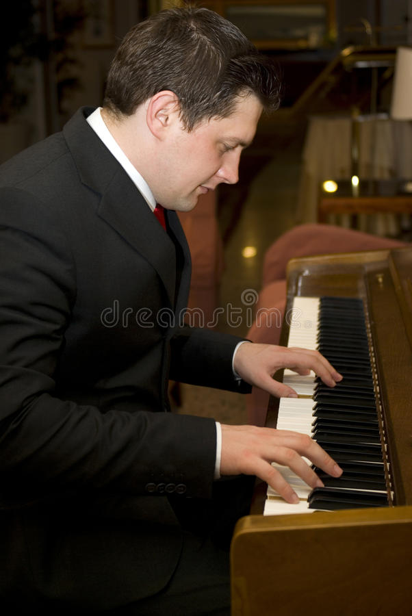 Man playing piano stock photography