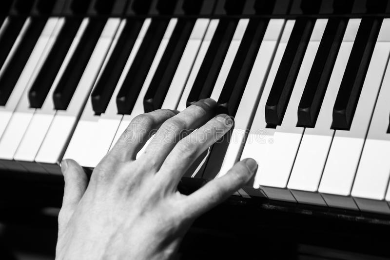 The man playing piano stock photography