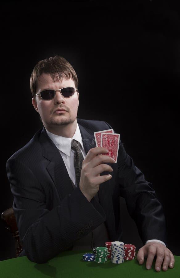 Man playing poker royalty free stock photography