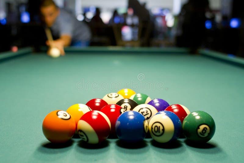 Man playing pool royalty free stock images