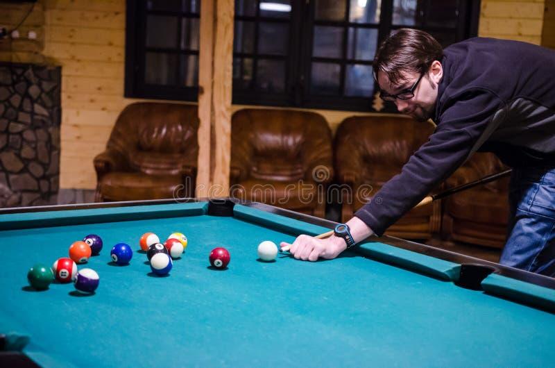 Man playing pool royalty free stock photos
