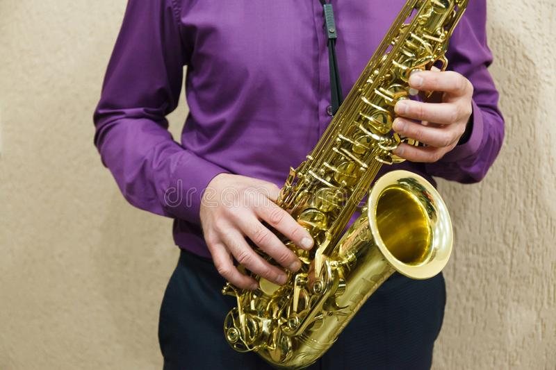 Man playing on saxophone stock image