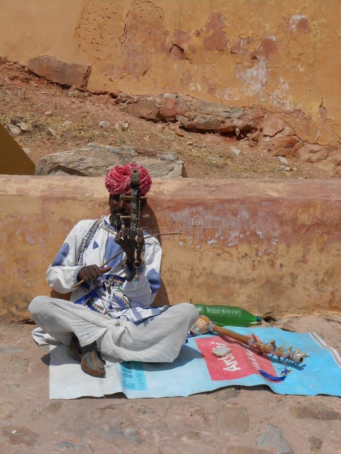Man playing `Sindhi Sarangi` - Amer fort . royalty free stock photography