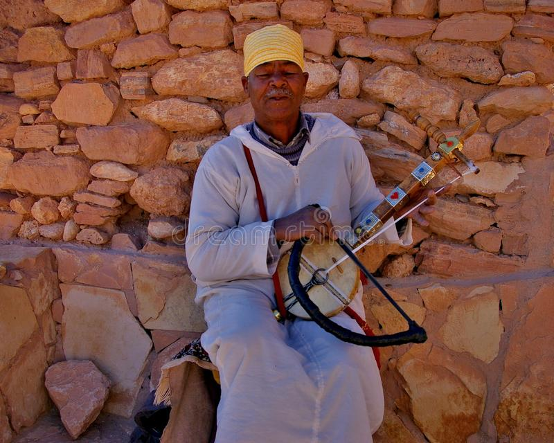 Man playing an stringed instrument in Marrakesh royalty free stock photography
