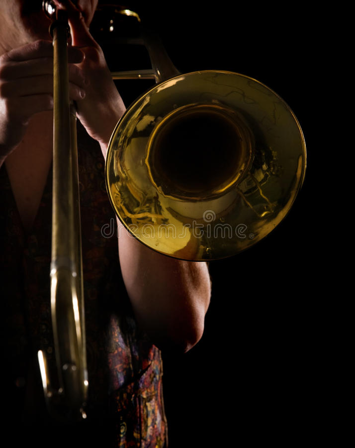 Man playing a trombone royalty free stock photography