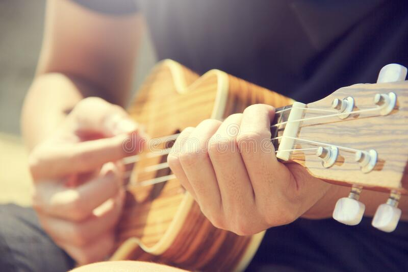 Man playing ukulele royalty free stock image