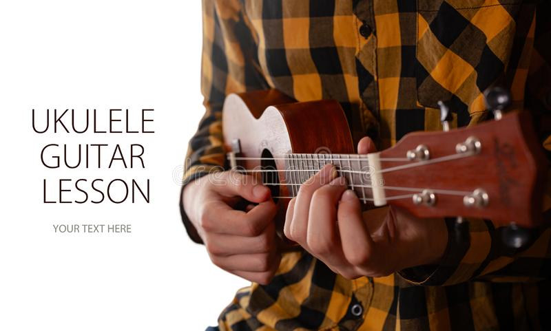 A man playing ukulele in close up view. royalty free stock photography