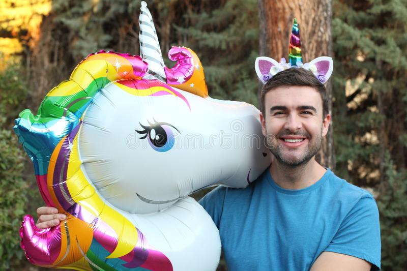 Man playing with a unicorn royalty free stock images