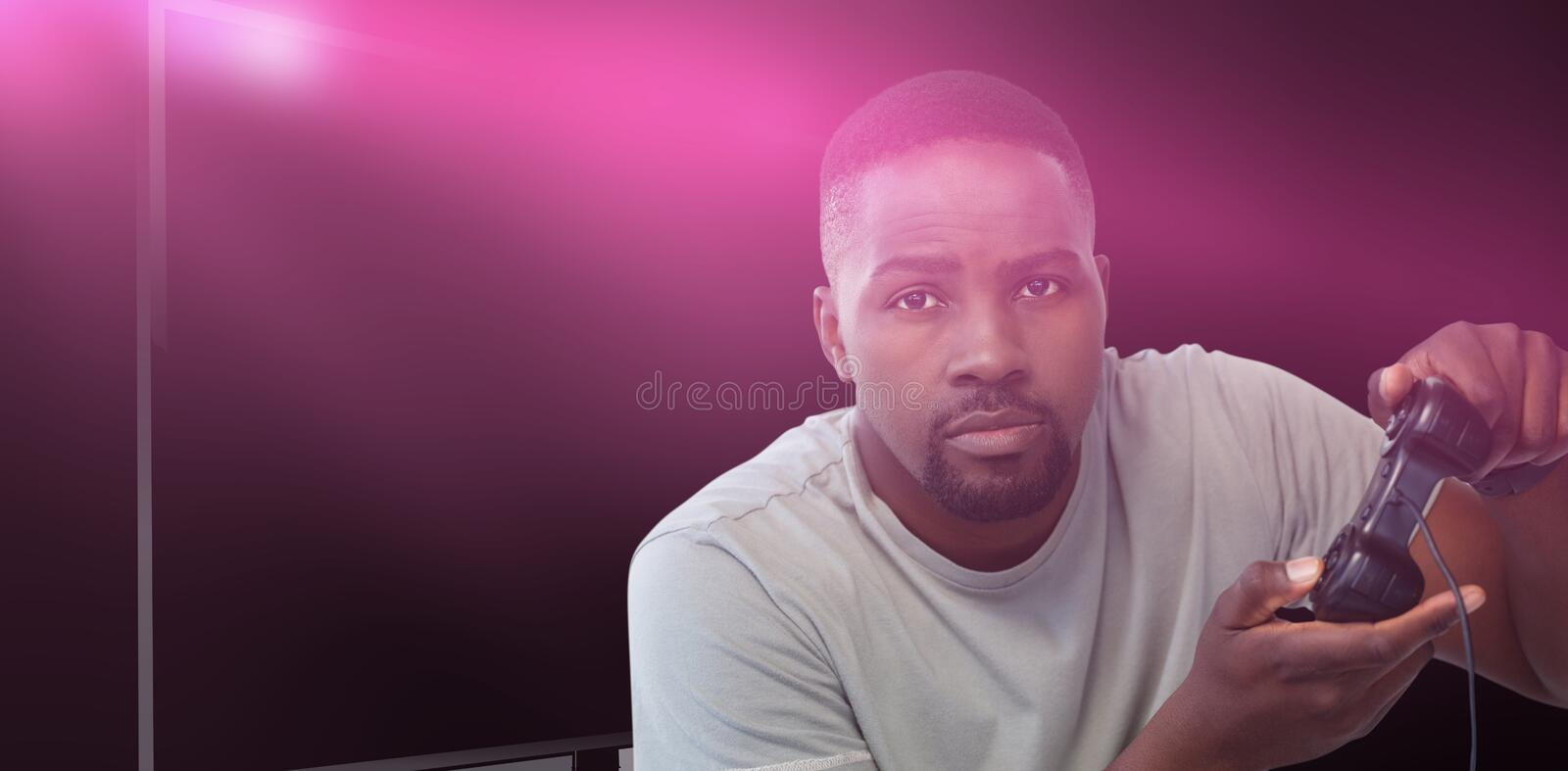Composite image of man playing video game against white background royalty free stock photo