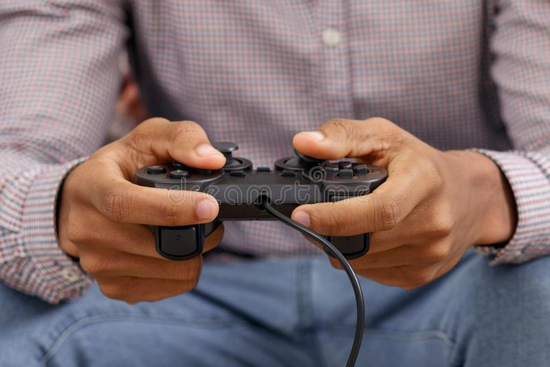 Man playing video games with joystick, closeup royalty free stock photo