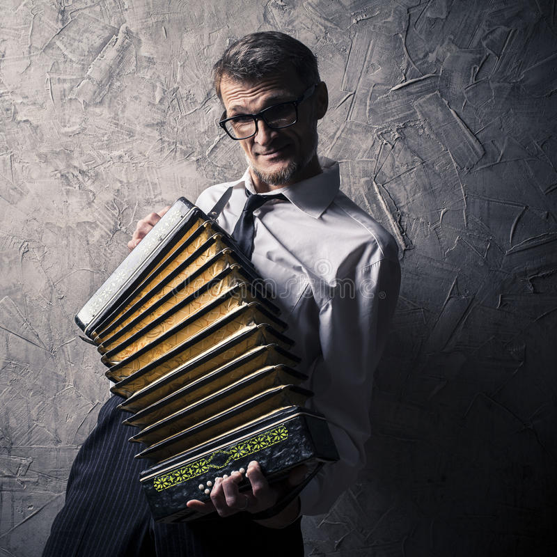 Man plays the accordion royalty free stock image