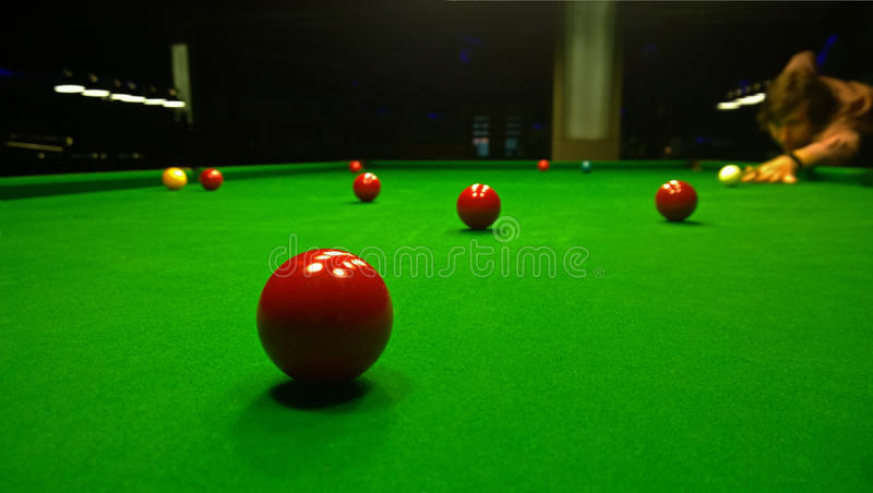 A man plays Billiards. Bright colorful balls to play snooker royalty free stock photos