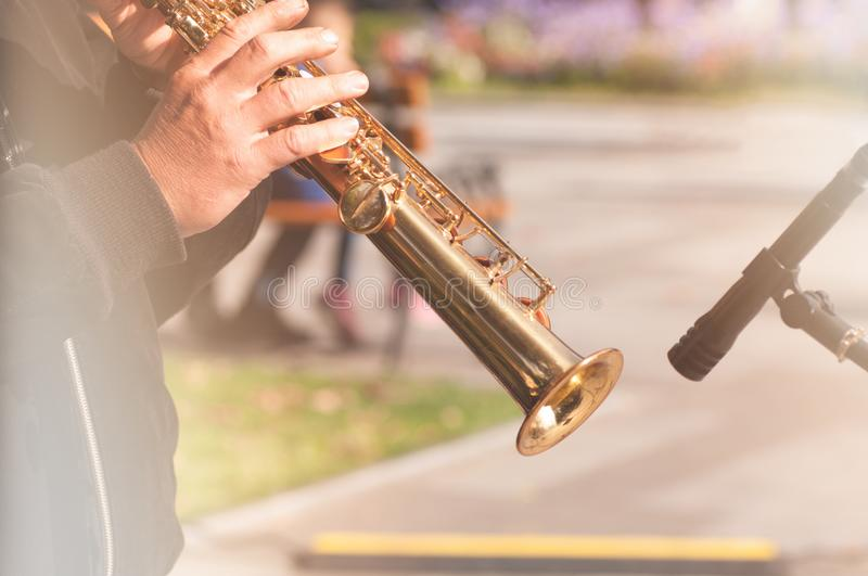 Man plays the clarinet on the street. Man playing the clarinet on the street, the effect is applied royalty free stock photo