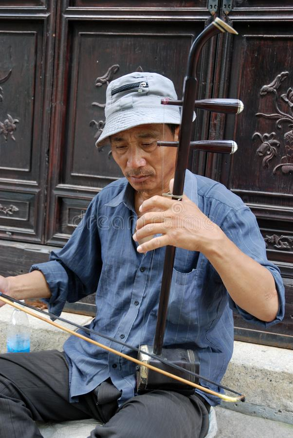 Man plays erhu, a traditional chinese instrument royalty free stock photos