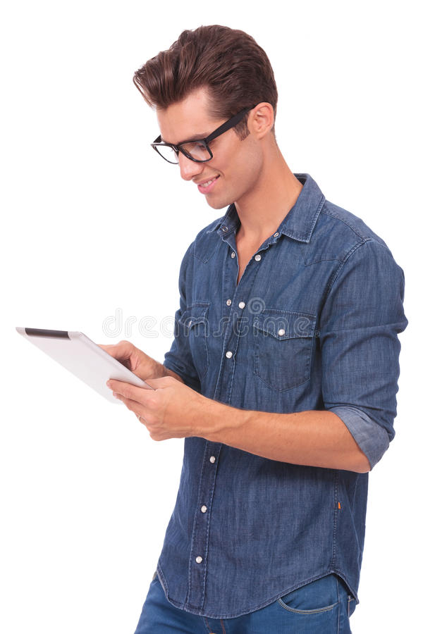 Man plays on his pad royalty free stock photography