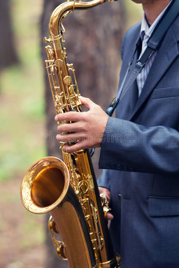 The man plays a saxophone royalty free stock photo