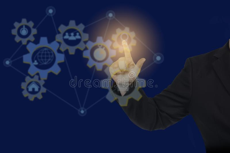 Man point on gear of global network connection and worldwide data, business network. Concept royalty free stock photos
