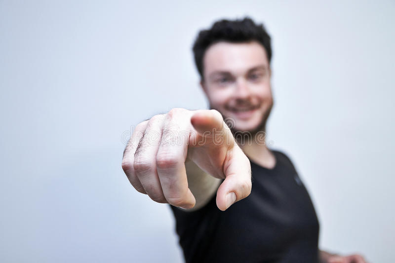 Man is pointed the finger. Happy man pointed the finger on white background, focus on the finger of model royalty free stock photo