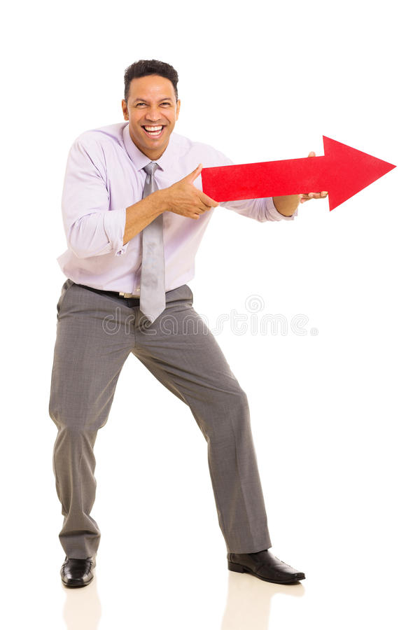 Man pointing arrow sign. Funny middle aged man pointing with arrow sign on white background stock photo
