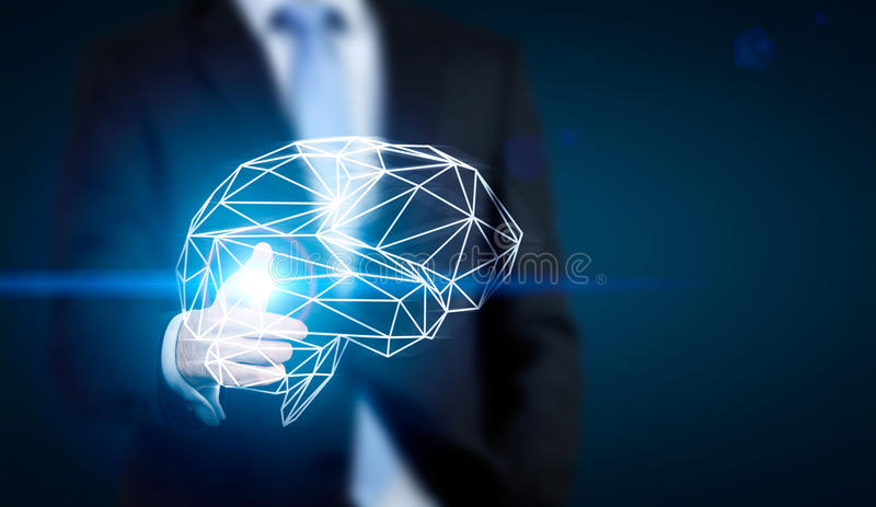 Man pointing at brain. Brainstorming concept with businessman pointing at abstract polygonal brain on dark blue background royalty free stock photo