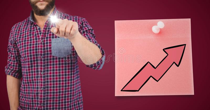 Man pointing with flare against maroon background with pink sticky note and arrow. Digital composite of Man pointing with flare against maroon background with royalty free stock photo