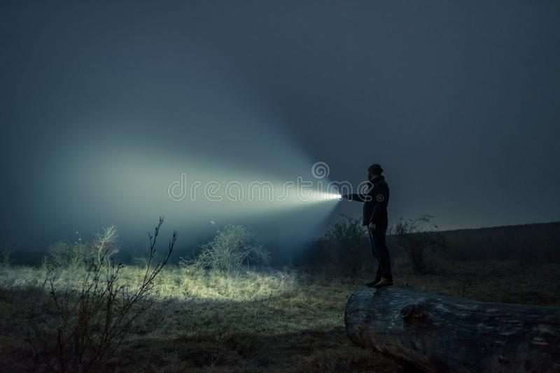 Searching with flashlight in outdoor stock photography