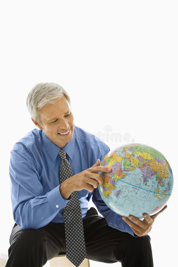Man pointing on globe. stock photography