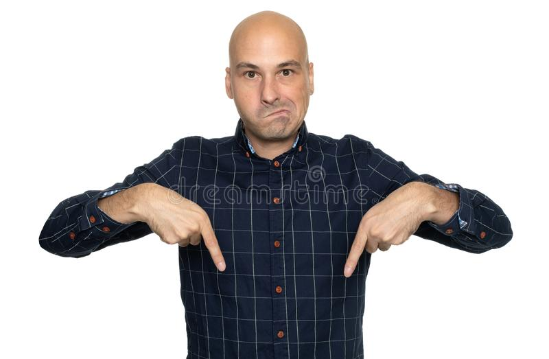 Man pointing his fingers down. Isolated royalty free stock photos