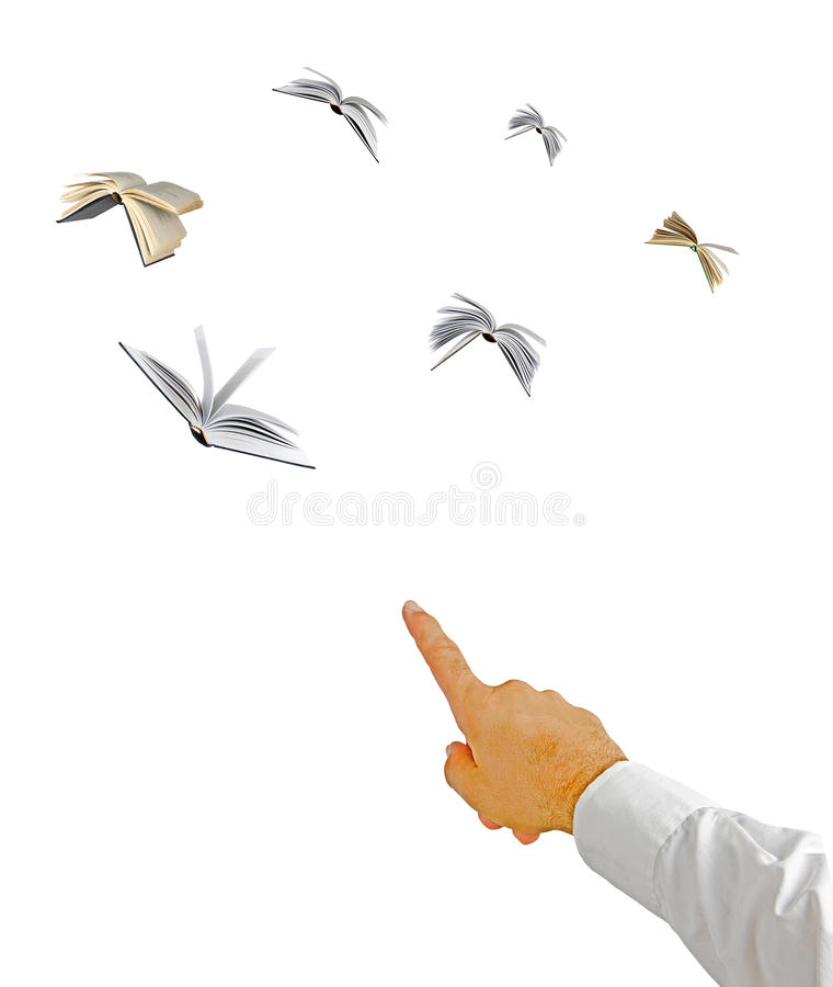Man pointing to flying Books. Man pointing to several flying Books stock photo