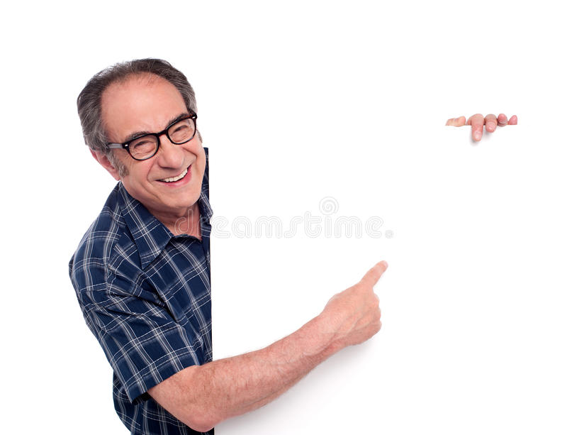 Man pointing at white blank poster royalty free stock photo