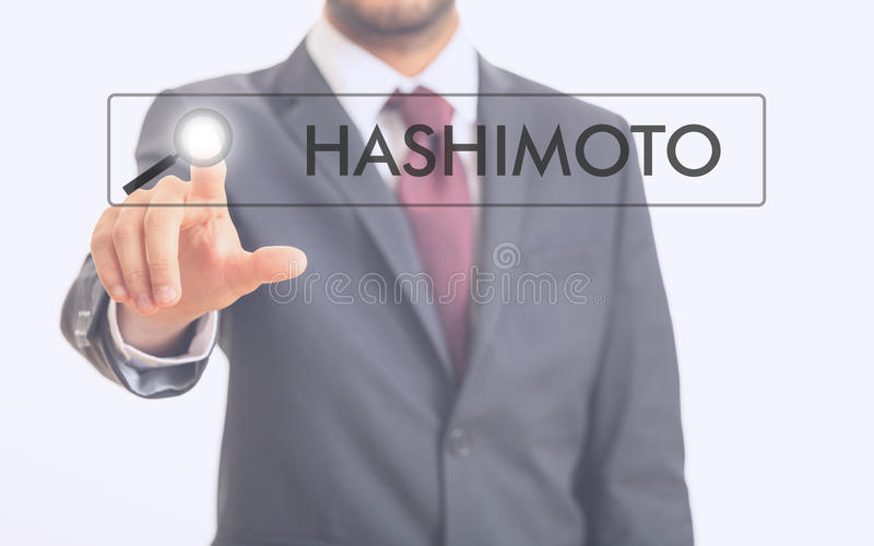 Man pointing at word Hashimoto royalty free stock photo