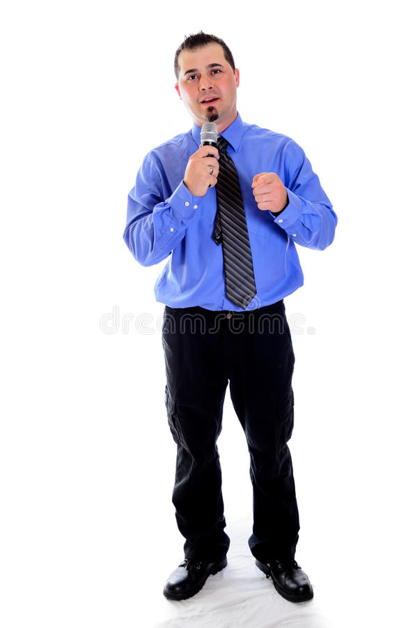 Man pointing at you speaking into microphone. A man in a shirt and tie pointing at you, speaking into microphone royalty free stock photography