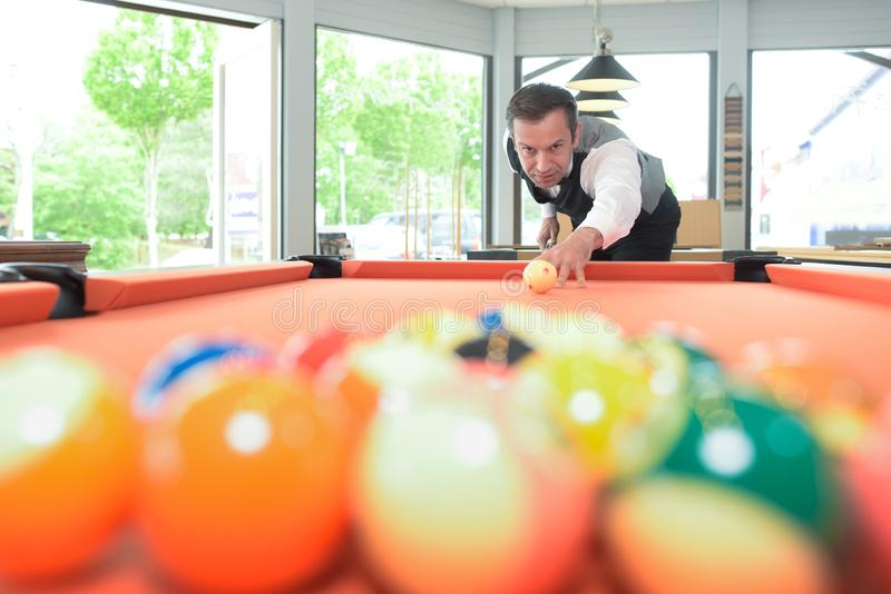 Man poised to break at pool table royalty free stock photography