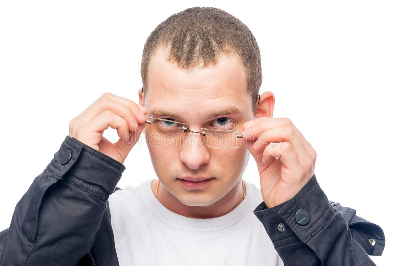 A man with poor eyesight correcting glasses. Isolated royalty free stock photography