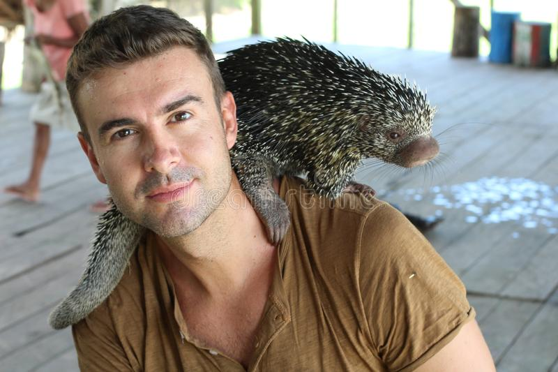 Man with a porcupine around his neck.  stock image