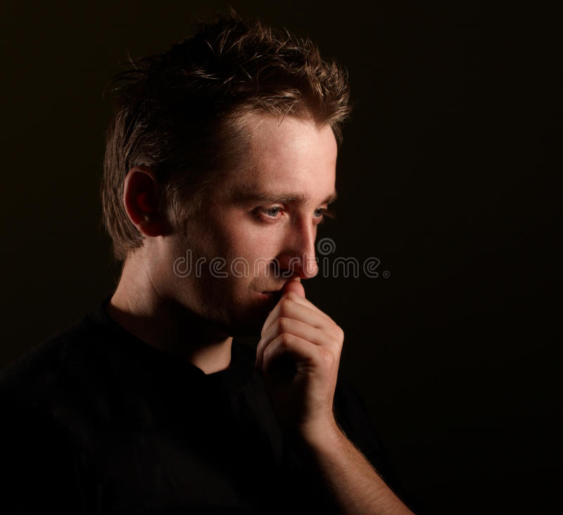 Man portrait. Dramatic photo on black background royalty free stock images